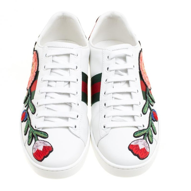 096bbeef7c4 Beautifully crafted from leather. Gucci White Floral Embroidered Leather  Ace Low Top Sneakers Size ...