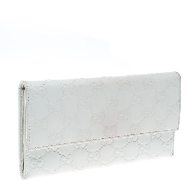 5cb1da5020a167 Gucci White Guccissima Leather Trifold Wallet For Sale at 1stdibs