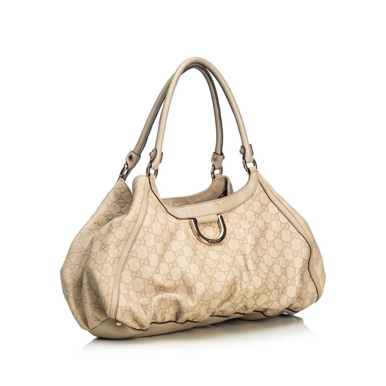 The Abbey D-Ring shoulder bag features a leather body, a rolled leather strap, a top zip closure, and interior zip and slip pockets. It carries as B+ condition rating.  Inclusions:  This item does not come with inclusions.  Dimensions: Length: 45.00