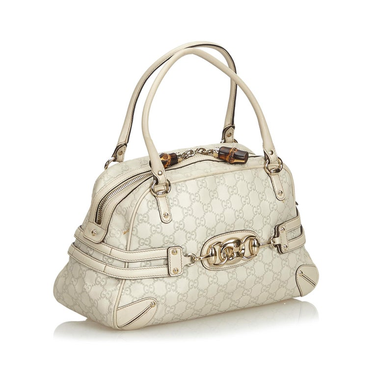 This handbag features a leather body, rolled leather handles, top zip closure, and an interior zip pocket. It carries as B+ condition rating.  Inclusions:  This item does not come with inclusions.  Dimensions: Length: 21.00 cm Width: 36.00 cm Depth: