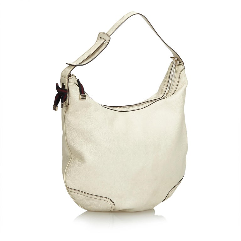 The Princy Hobo Bag features a leather body, flat leather strap, a top zip closure, and interior zip and slip pockets. It carries as B+ condition rating.  Inclusions:  This item does not come with inclusions.  Dimensions: Length: 31.00 cm Width: