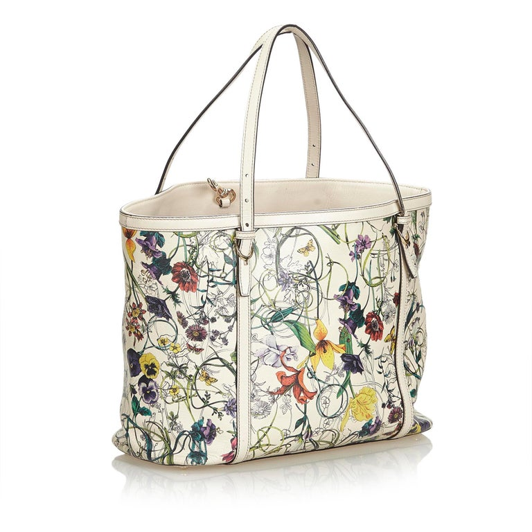 The Nice tote bag features a printed leather body, flat leather straps, an open top, and interior zip and slip pockets. It carries as B+ condition rating.  Inclusions:  Dust Bag  Dimensions: Length: 28.00 cm Width: 45.00 cm Depth: 15.00 cm Shoulder