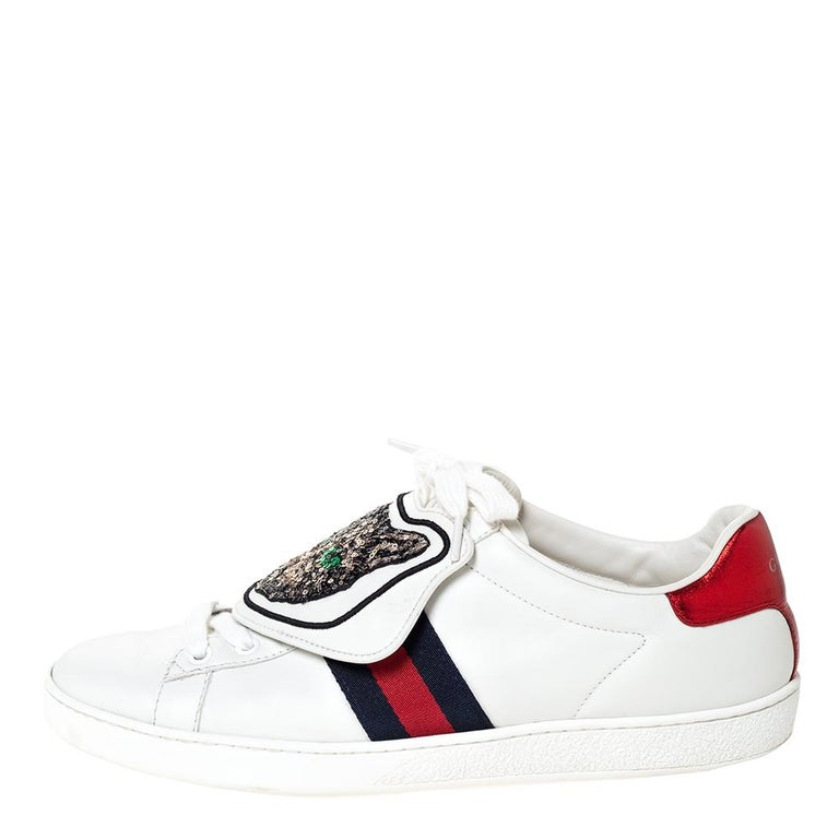 Stacked with signature details, this Gucci pair is rendered in white leather and is designed in a low-cut style with lace-up vamps. They have been fashioned with the iconic web stripes and removable patches. Complete with red and blue trims carrying