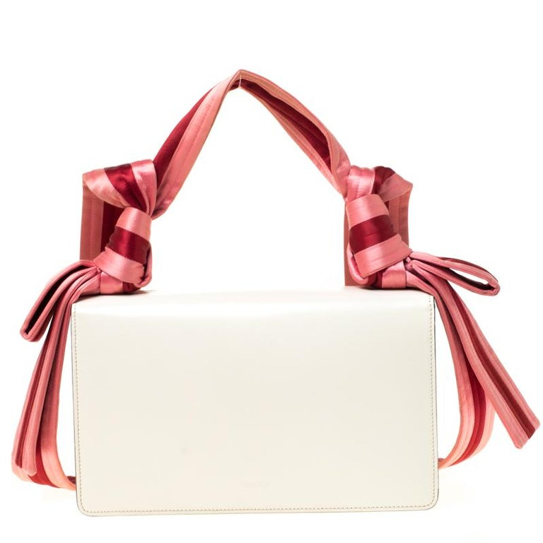 The Naga bag was released by Gucci as part of the brand's Spring/Summer 2017 collection and it is a beauty to behold. The bag we have here is crafted from leather and equipped with two satin compartments. On the flap, there are details of chevron