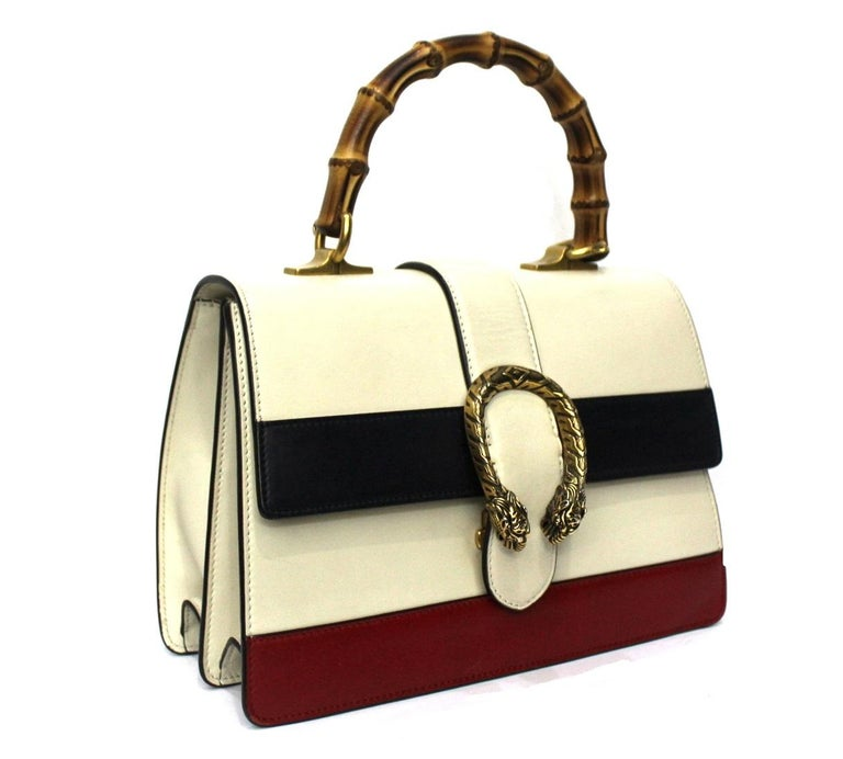 Fabulous Gucci Dionysus line bag made in white, red and blue leather with web strap and bamboo top handle.  Closure with slider, internally quite large.  The bag is in excellent condition.