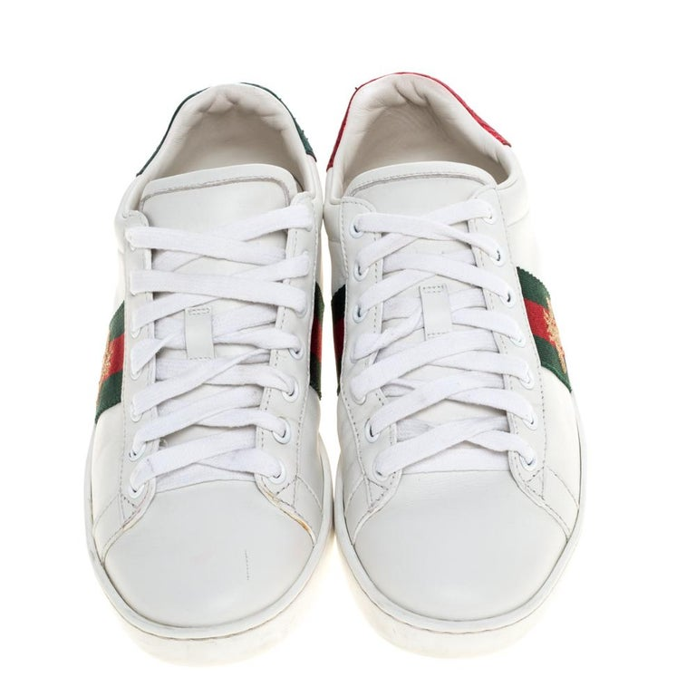 Stacked with signature details, this Gucci pair is rendered in leather and is designed in a low-cut style with lace-up vamps. They have been fashioned with the signature bee embroidery on the iconic web stripes. Complete with red and green trims
