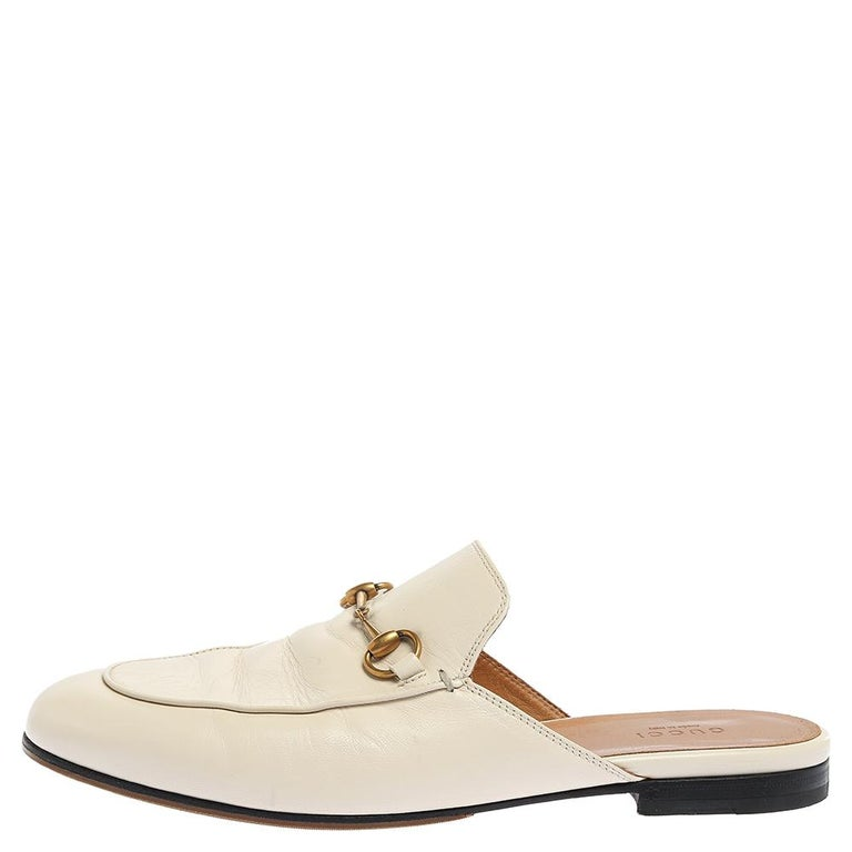 First introduced as part of Gucci's Fall Winter 2015 collection, the Princetown mules are an absolute favorite worldwide and have been worn by countless celebrities. These mules have been designed in white leather and detailed with the signature