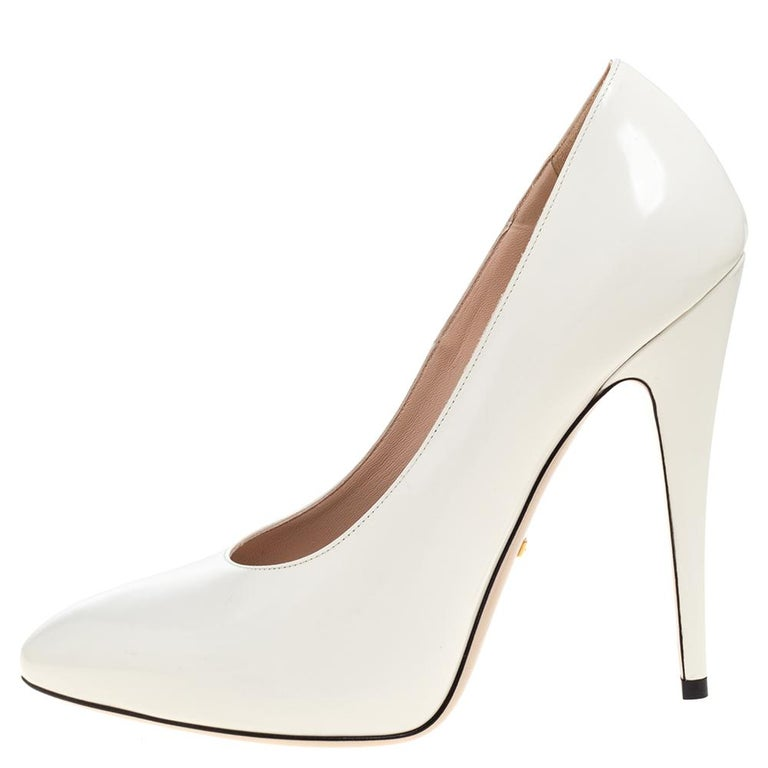 You can never go wrong with these classic pumps from the iconic house of Gucci. Crafted in Italy and made from quality leather, they come in a lovely shade of white. They are styled with round toes, 13 cm heels, insoles with brand labels, and