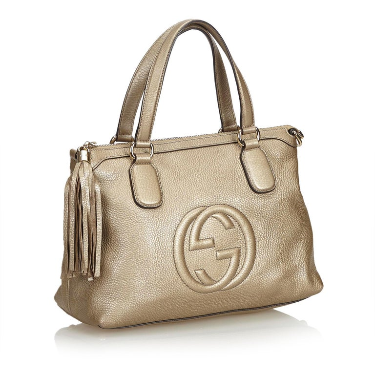This handbag features a leather body, flat leather handles, top zip closure, and interior zip and open pockets. It carries as B+ condition rating.  Inclusions:  Dust Bag  Dimensions: Length: 22.00 cm Width: 32.00 cm Depth: 12.00 cm Hand Drop: 14.00