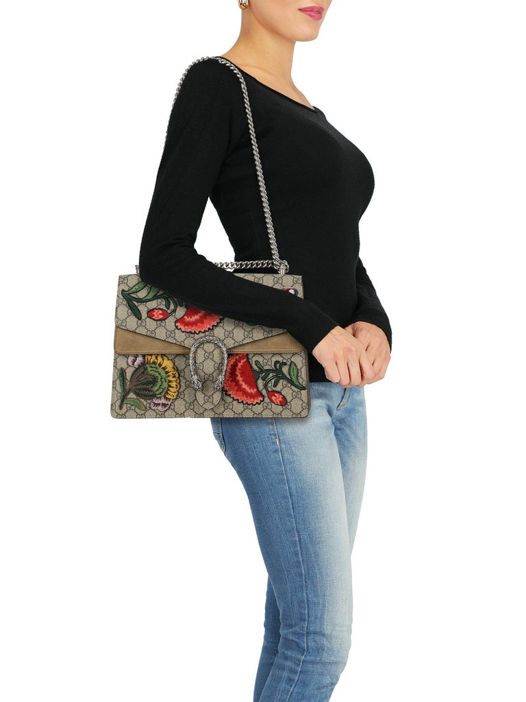 Product Description: Dionysus, fabric, other patterns, internal logo, suede, pressure lock closure, gunmetal hardware, internal zipped pocket, multiple internal compartments, leather lining, fabric lining, flowers application, embroidered