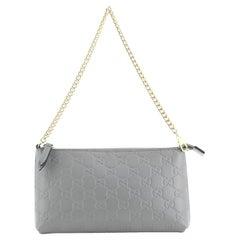 Gucci Wrist Wallet Guccissima Leather