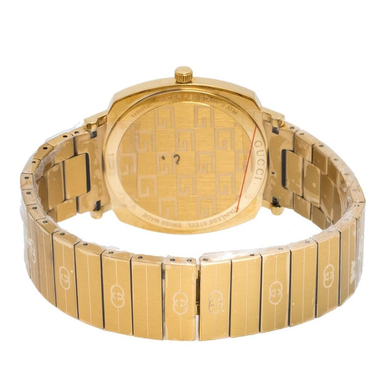 An impeccably-finished wristwatch by Gucci to grace your wrist . Made from yellow gold PVD coated stainless steel, the watch has signature GG logo appearing all over. It has three apertures on the case, one of which is a date