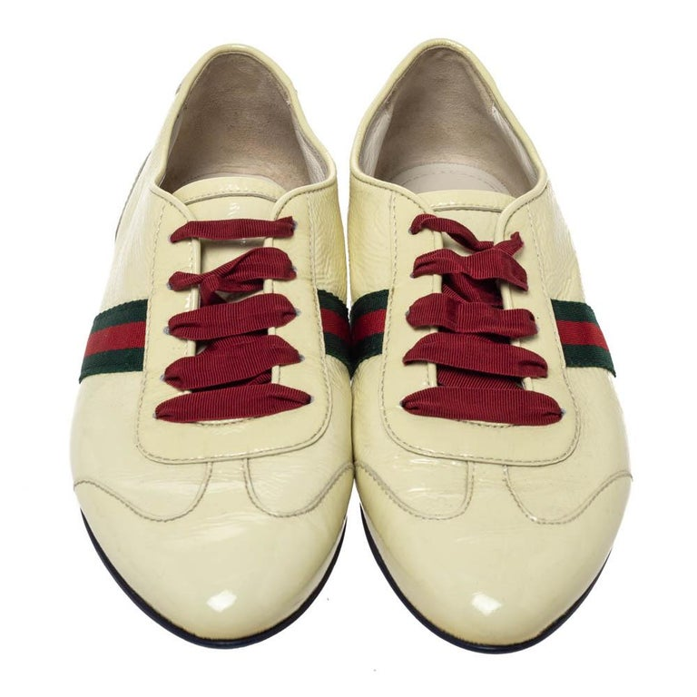 Strut out in style with this pair of sneakers from Gucci. These patent leather sneakers are fashionable and definitely worth the splurge. This low top pair features the signature web detail on the sides and brand logo at the counters. The trendy
