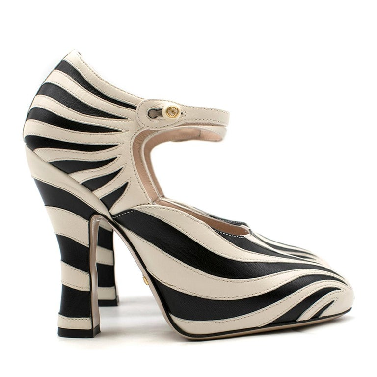Gucci Zebra Leather Pump  - Zebra paneling leather pump  - Round closed toe - High thick heels - Slim fastening strap with Gucci logo embroidered in the pearl button - Nude leather lining and insole, with a black snake detail and shiny gold Gucci