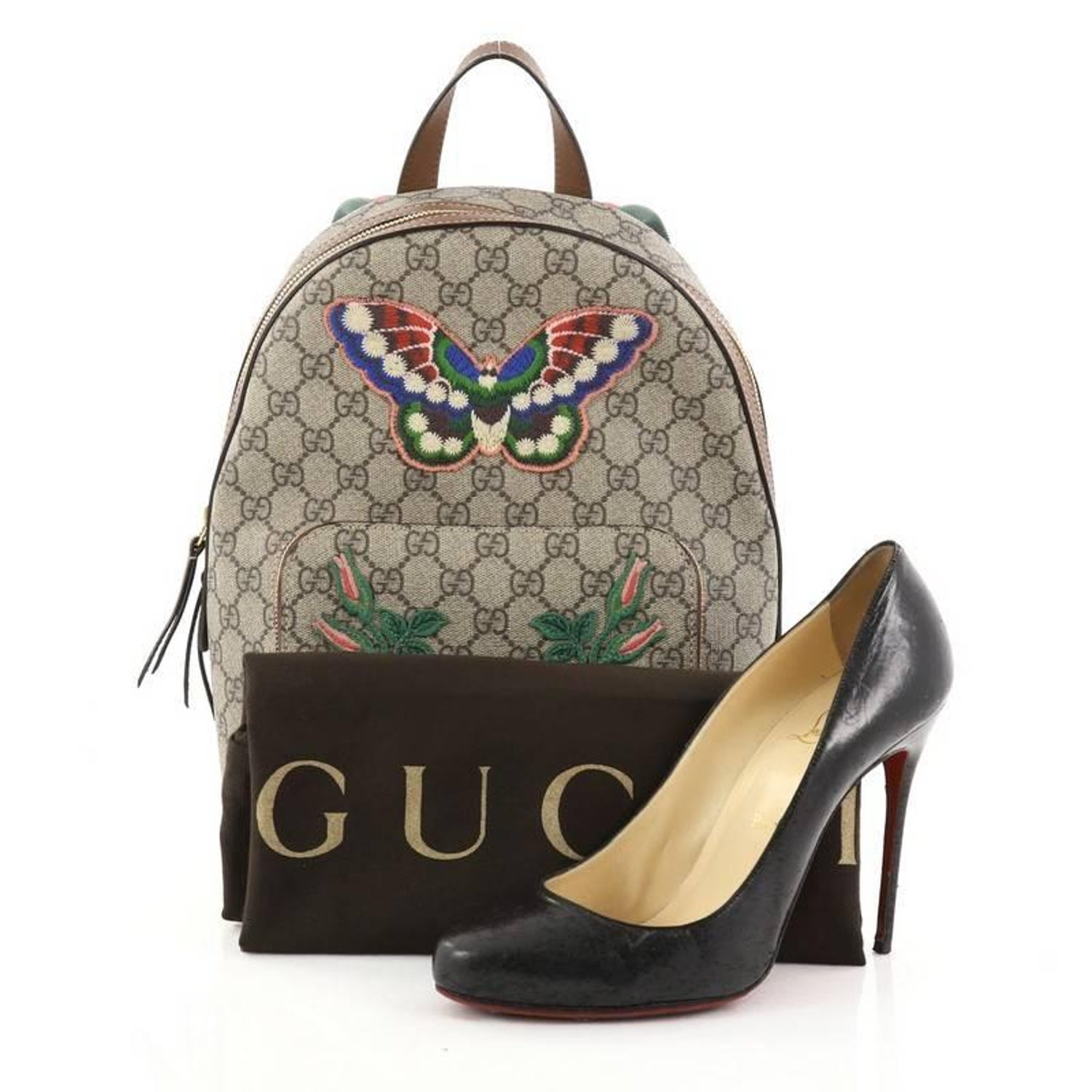 24d58467b8e4 Gucci Zip Pocket Backpack Embroidered GG Coated Canvas Small at 1stdibs