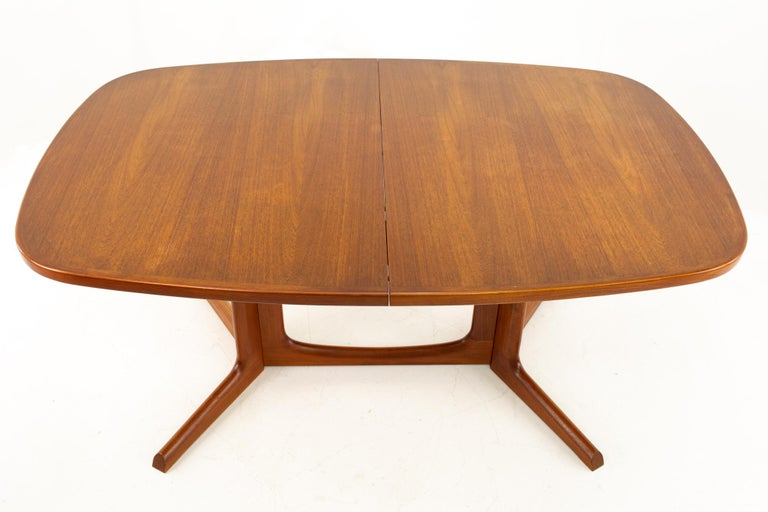 Gudme Mobelfabrik midcentury dining table with 2 leaves  Table without leaves measures: 63 wide x 41.5 deep x 29 high with a chair clearance of 27 inches; width with leaves is 102 inches  This price includes getting this piece in what we call