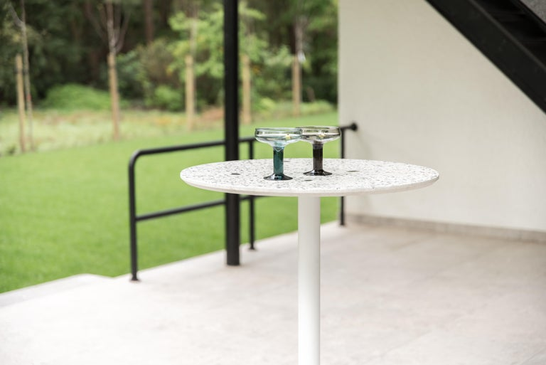 'I' is a collection of tables: coffee / side tables, dining tables, bar tables. 