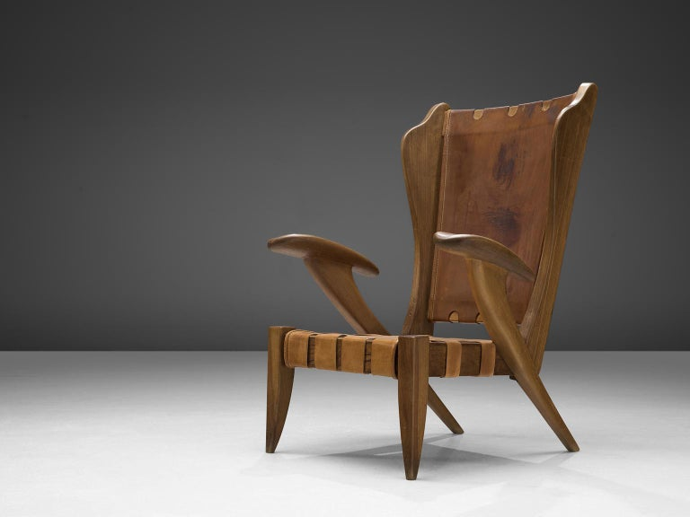 Guglielmo Pecorini, high back chair, in ash wood and leather, by Guglielmo Pecorini, Italy, 1950s.  Beautiful Italian curved armchair in solid ashwood with cognac leather seat. The solid bent frame shows lovely vibrant lines and, such as the