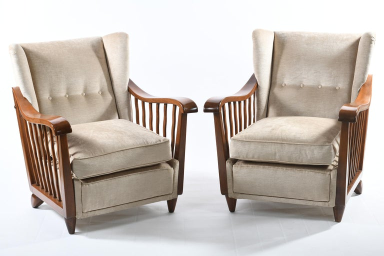 Four armchairs designed and produced by the Designer Guglielmo Pecorini Florence Italy in the early 1940s and made with a beautiful carved solid walnut, published in the famous Domus magazine directed by Gio Ponti, see attached photo.
