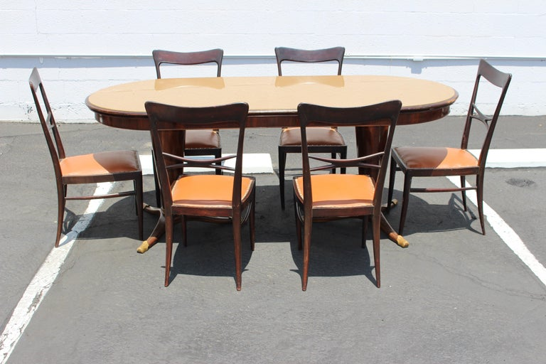 Italian 1950s Paolo Buffa style dining room set. Walnut base mirrored glass top and the brass feet, table can be dismantle for the easy transport.