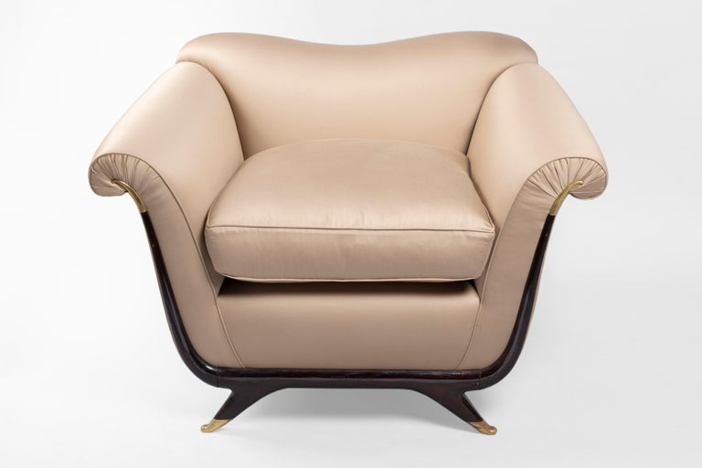 Elegant, very chic, two armchairs upholstered in a beautiful taupe silk fabric (Pierre Frey). The designer Guglielmo Ulrich gave a beautiful shape to these pieces, sensuality with his unique Italian taste and savoir faire. Can be sold with similar