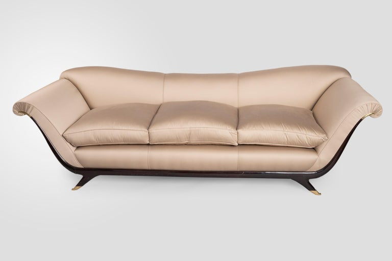 Luxurious, sofa upholstered in a beautiful taupe silk fabric (Pierre Frey). It is an elegant sofa designed by Italian artist Guglielmo Ulrich who became head designer home furnishing company Arca. (well-known for high quality and premium materials).