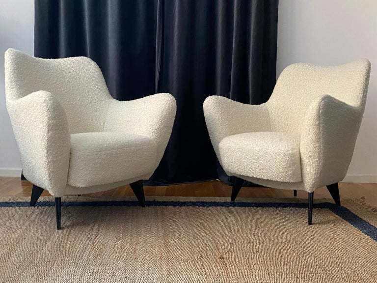 A pair of organic lounge chairs / armchairs. Designed by Guglielmo Veronesi. Produced by I.S.A. Bergamo, Italy, 1950s. Fully restored and reupholstered in a brand new Pierre Frey bouclé fabric. Legs in black painted walnut.  Other designers