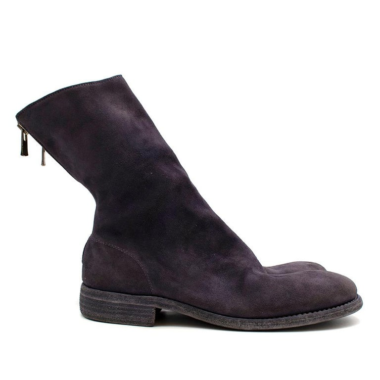 Guidi Suede Distressed Zipped Boots  - Classic back zipped boots in suede with silver hardware - Features stacked sole construction - Distressed & exposed sole look - This item fits small - 1/4 length boot  - Round toes   Made in Italy  Fabric