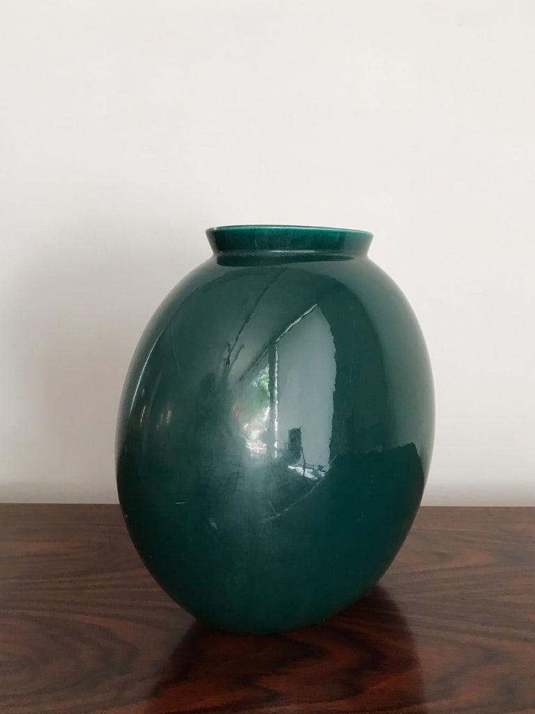 "Italian Mid-Century Modern design ceramic vase model ""1316/4"" designed by Guido Andloviz and produced by S.C.I. (Società Ceramica Italiana, Laveno) with green semi-gloss enamel, 1950s Marked ""Lavenia 9-51"" and with the graphic symbol of the"