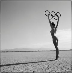 Olympic Games - nude model in desert holding the olympic rings up