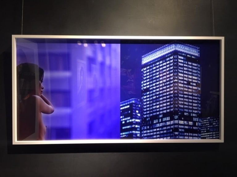 Thoughts across the sky - diptych of a nude model and skyscrapers in blue shades - Photograph by Guido Argentini