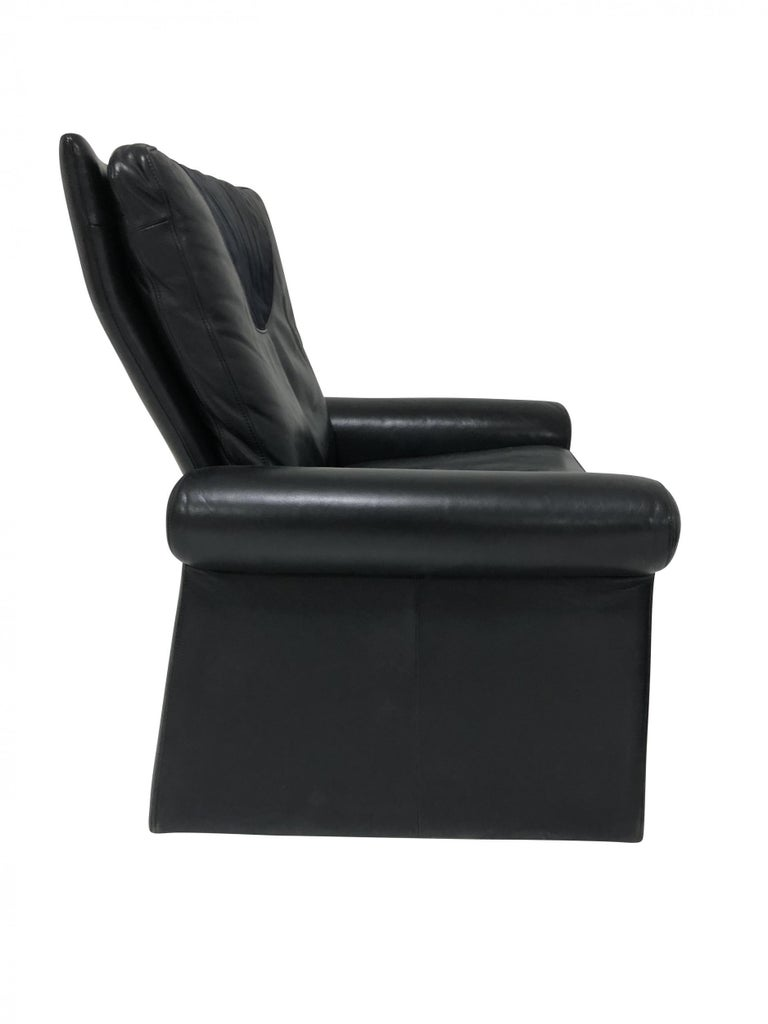 Lounge chair with ottoman designed by Guido Faleschini for Mariani. Retailed in America by Pace Collection. Original black leather upholstery with black suede at head rest.  Measures: Chair 35 wide x 32 deep x 37 tall x 18 seat Ottoman 28 wide x