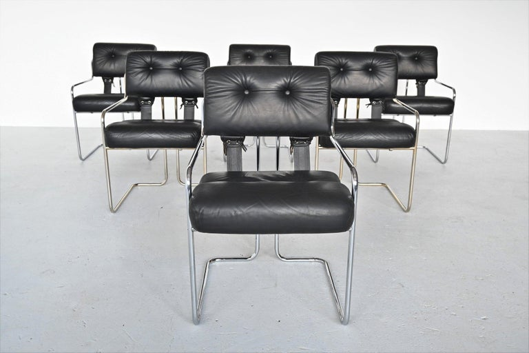 Fantastic set of 6 Tucroma dining armchairs designed Guido Faleschini for i4 Mariani, Italy 1970. These beautiful shaped chairs are hard to find in a set of 6. They have a chromed tubular metal frame and a padded leather seat and back that are