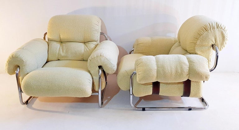 A pair of lounge chairs by Italian designer Guido Faleschini for Mariani, circa 1975. Reupholstered in a soft pale yellow salt and pepper fabric. Some wear to the chrome. The chrome can be re-finished upon request please ask for quote.