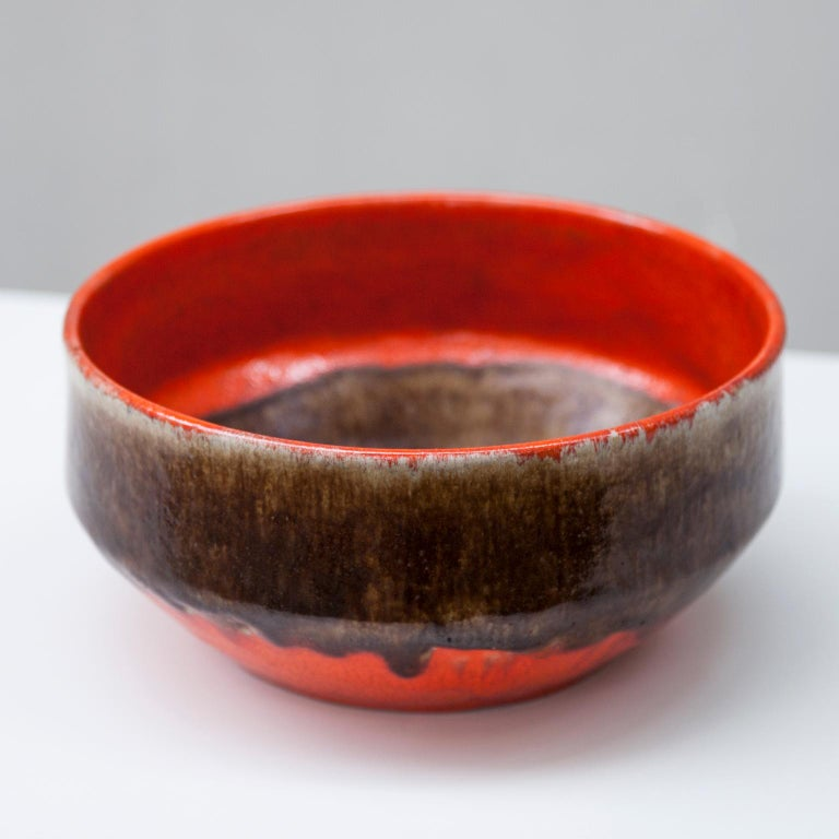Huge ceramic bowl by Guido Gambone with brown and orange glaze.