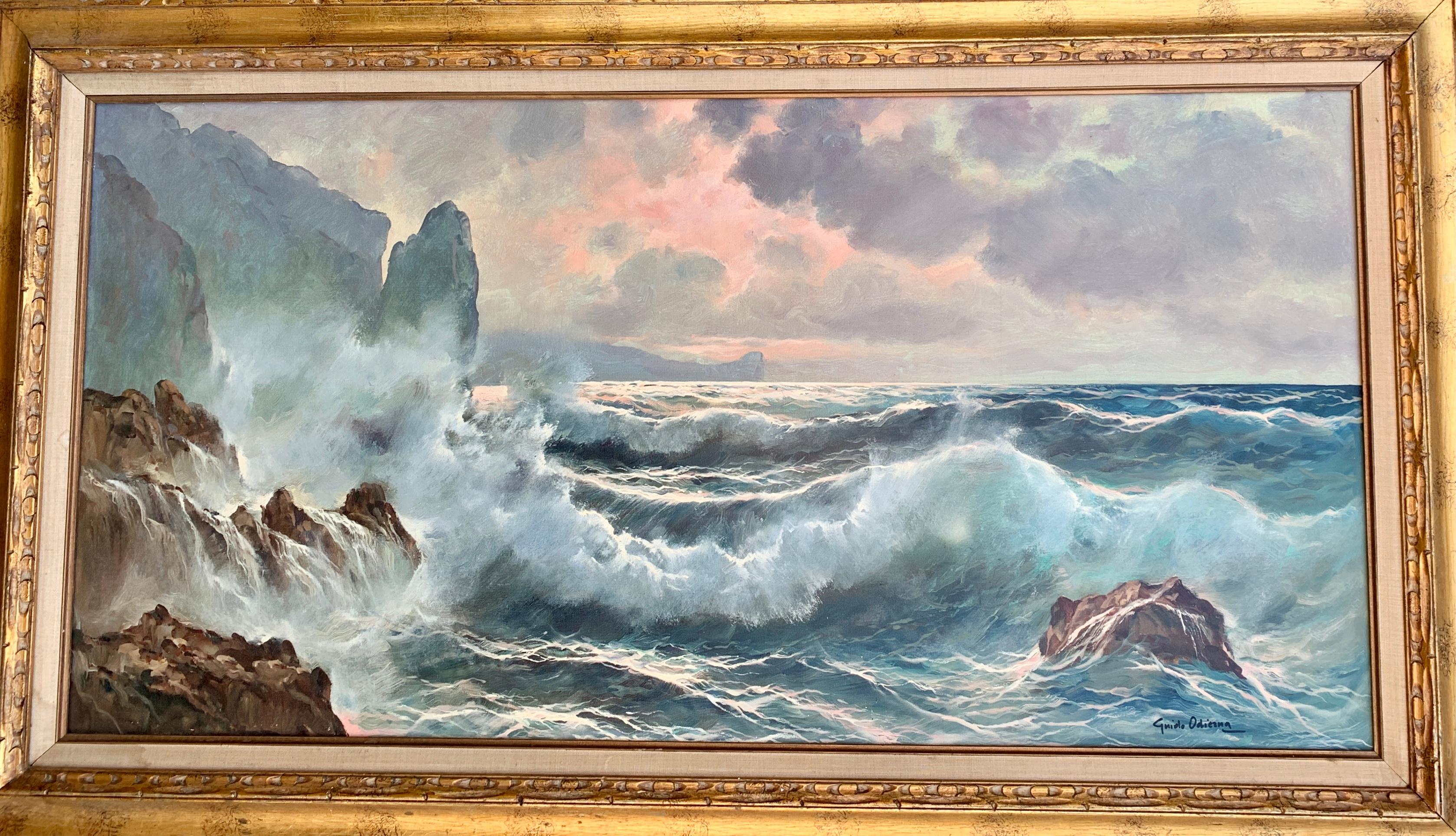 Southern Italian Coastal sea scene, waves crashing onto rocks, with sunsetting
