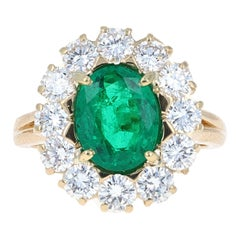 Guild Certified, 2.47 Carat Oval Shape Natural Emerald and Diamond Cocktail Ring