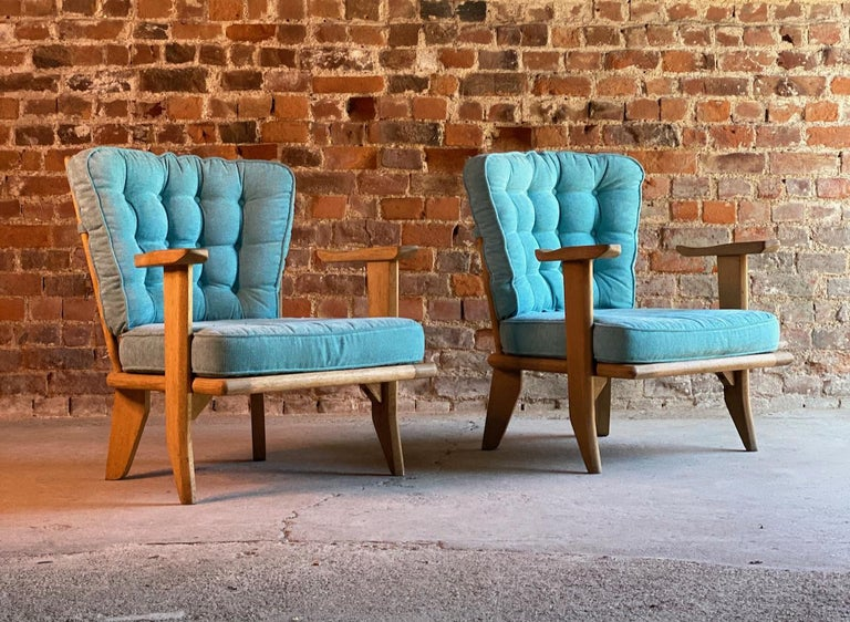 Guillerme & Chambron armchairs lounge chairs, France, circa 1950s  Striking pair of midcentury French design Robert Guillerme & Jacques Chambron, Votre Maison light Oak easy lounge chairs France Circa 1950s, upholstered in a beautiful sky blue