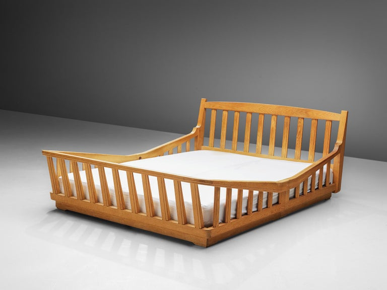 Guillerme et Chambron, double bed in oak, France, 1960s  This bed's main feature is obvious: It's all about the wood work. The excellent crafted frame almost resembles a basket, which gives it a very comfortable an cosy feel to lie in.  The French