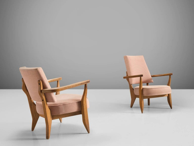 Jacques Chambron and Robert Guillerme, Him and Hir easy chairs, beige and pink fabric, oak, France, 1950s  This sculptural set of easy chairs by Guillerme and Chambron is very well executed and made out of solid, carved blond oak. This set of