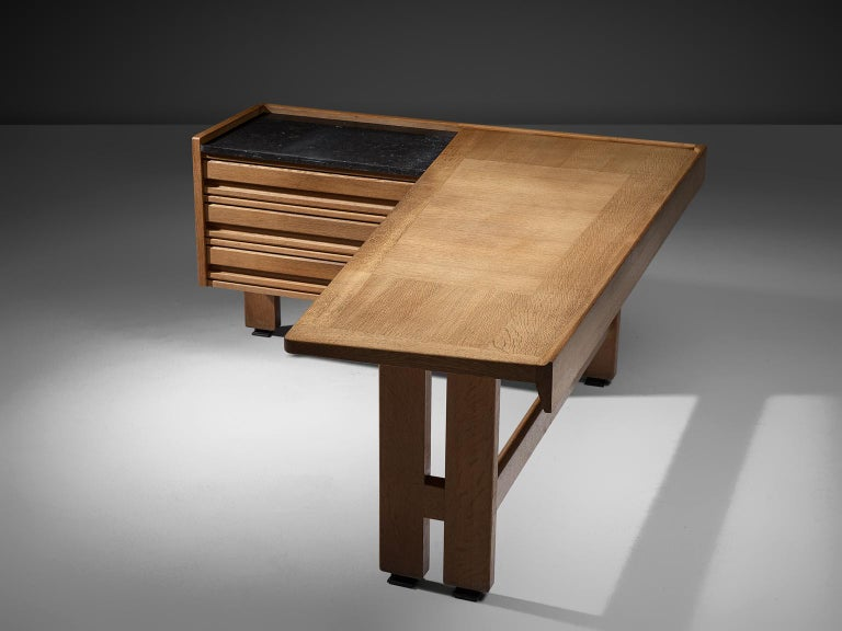 Guillerme et Chambron, desk, oak and granite, by France, 1960s.   Corner desk by French designer duo Guillerme and Chambron. This executive desk holds the characteristic decorations and lines of this designer duo. The top is inlaid with wood in
