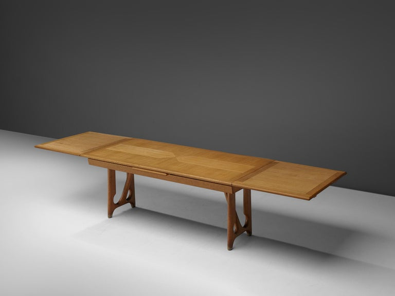 Guillerme et Chambron, dining table, oak, France, 1965.  Extendable dining table in solid oak by French designers Guillerme et Chambron. This elegant table shows interesting details. Most attractive is the inlayed top. These graphical patterns show