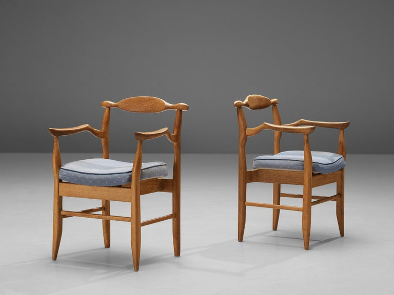 Guillerme & Chambron for Votre Maison, pair of armchairs 'Fumay', oak, fabric upholstery, France, 1960s.  Pair of armchairs Guillerme and Chambron. These chairs show the characteristic frame of this French designer duo. Tapered legs and the