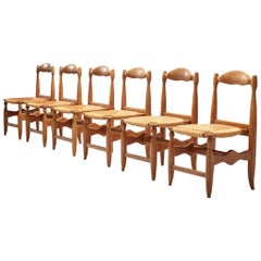 Guillerme & Chambron Set of Six Dining Chairs Model 'Charlotte' in Oak and Cane