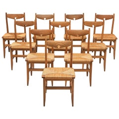 Guillerme & Chambron Set of Ten Chairs in Oak and Cord