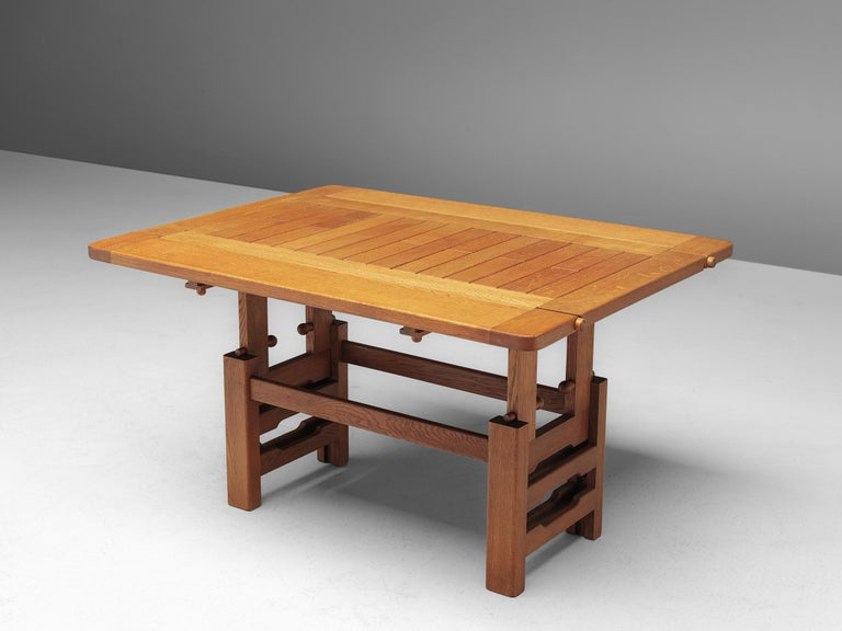 Guillerme et Chambron, adjustable dining table, oak, 1960s.  Large rectangular dining table with inlayed top. This table is perfect to place against a wall, or for additional seat placed free in the interior thanks to the drop-leaf. The table can
