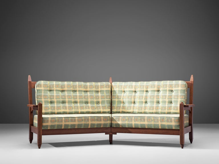 Guillerme et Chambron for Votre Maison, curved sofa, solid oak and fabric, France, 1960s.  This sculptural carved oak sofa is designed by Guillerme and Chambron. The design duo is known for their sculptural, crafted solid oak furniture. This