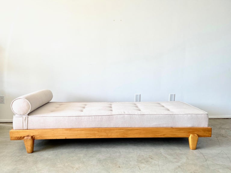 Wonderful daybed attributed to Guillerme et Chambron  Slim oak frame with Great angular legs.  New neutral linen upholstery.