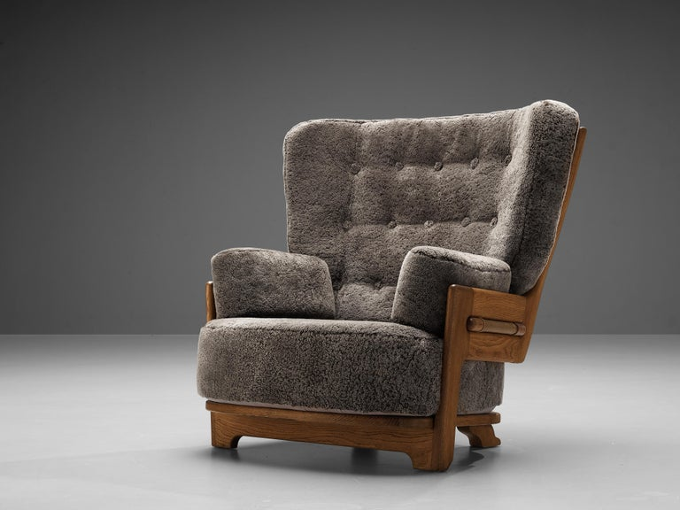 Guillerme & Chambron for Votre Maison, 'Denis' lounge chair, fabric and oak, France, 1960s  This lounge chair is reupholstered on request in our in-house atelier. Extraordinary Guillerme and Chambron lounge chair in solid oak with the typical