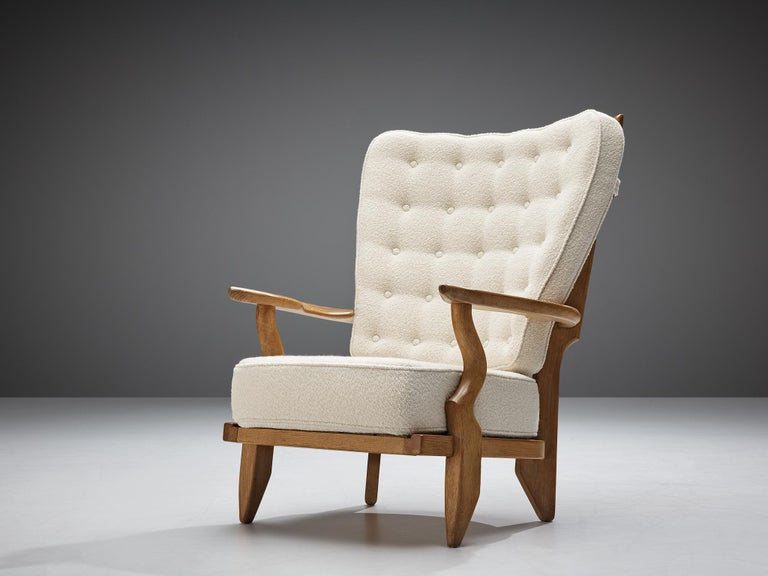 Guillerme et Chambron, customizable 'Grand Repos' lounge chair oak, white woolen Pierre Frey upholstery, oak, France, 1960s.  Guillerme and Chambron are known for their high quality solid oak furniture, from which this is another great example.